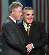 US President Bill Clinton (L) and Republic of Ireland Prime Minister Bertie Ahern shake hands 04 September after completing the first electronic signing of a trade agreement between two nations in Dublin, Ireland.   The agreement was completed at the Gateway computer assembly plant near Dublin.  (ELECTRONIC IMAGE)   AFP  PHOTO    Bob PEARSON