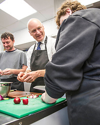 Pictured: Mr FitzPatrick was joined at the preparation table by volunteers David Keogh and Donna McArdle <br /> New Public Health Minister Joe FitzPatrick visited Bridgend Inspiring Growth centre, Bridgend Farmhouse in Edinburgh to launch the Scottish Government's diet and healthy weight delivery plan. <br /> <br /> Mr FitzPartick joined volunteers to prepare some salad for today's lunch.<br /> <br /> Ger Harley | EEm Date