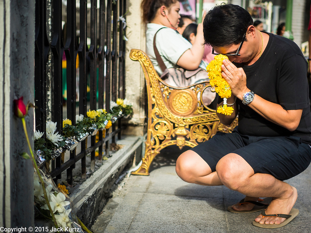 22 AUGUST 2015 - BANGKOK, THAILAND: A man prays at the spot where a bomb was detonated inside Erawan Shrine. Erawan Shrine in Bangkok reopened Wednesday, August 19, after more than 20 people were killed and more than 100 injured in a bombing at the shrine Monday, August 17, 2015. The shrine is a popular tourist attraction in the center of Bangkok's high end shopping district and is an important religious site for Thais. No one has claimed responsibility for the bombing.             PHOTO BY JACK KURTZ