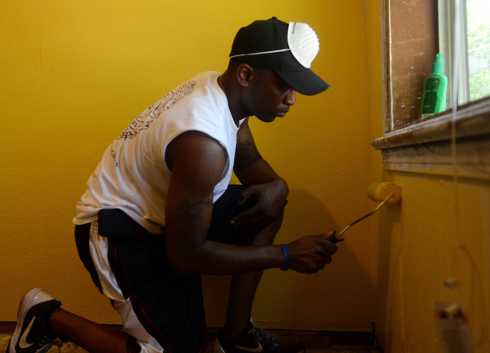 Sgt. Laron Smith of the Hattiesburg Police Department crime suppression team repaints the Florence Street house of a disabled citizen on Tuesday morning. The team put new paint on all the walls, as well as general maintenance work. Bryant Hawkins/The Hattiesburg American