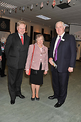 Left to right, JANET GRANT, THOMAS WOODCOCK and LT.COL.HARRY SCOTT at a reception to view and buy cushions, quilts, bags and gifts Hand-stitched in British prisons held at The Riffles Club, 56 Davies Street, London W1 on 26th April 2012.