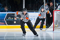 KELOWNA, CANADA - JANUARY 26: Tyler Adair and Kevin Bennett, referees, enter the ice as the Prince Albert Raiders visit the Kelowna Rockets on January 26, 2013 at Prospera Place in Kelowna, British Columbia, Canada (Photo by Marissa Baecker/Shoot the Breeze) *** Local Caption ***