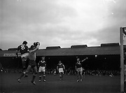 11/09/1960<br /> 09/11/1960<br /> 11 September 1960<br /> Soccer International Ireland v Iceland at Dalymount Park, Dublin. Jack Fitzgerald (right) points to the goal as Hennessy (No.8) goes up for the header against Iceland keeper Danielsson as the ball is crossed in from a corner for Ireland.