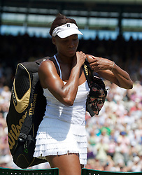 LONDON, ENGLAND - Tuesday, June 29, 2010: Venus Williams (USA) collects her bags as she exits Court No. 1 after losing the Ladies' Singles Quarter-Final match on day eight of the Wimbledon Lawn Tennis Championships at the All England Lawn Tennis and Croquet Club. (Pic by David Rawcliffe/Propaganda)