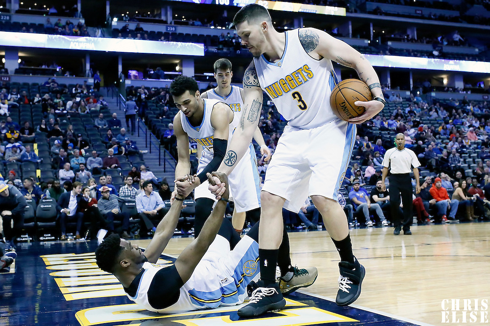 01 February 2016: Denver Nuggets guard Mike Miller (3) and Denver Nuggets guard Jamal Murray (27) help Denver Nuggets guard Emmanuel Mudiay (0) to stand up during the Memphis Grizzlies 119-99 victory over the Denver Nuggets, at the Pepsi Center, Denver, Colorado, USA.