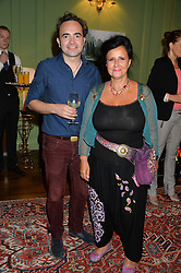 HUGH OWEN-JONES and COUNTESS CAROLINDA TOLSTOY at a Bastille Day Cocktail Party at L'Escargot, 48 Greek Street, London on 14th July 2014.
