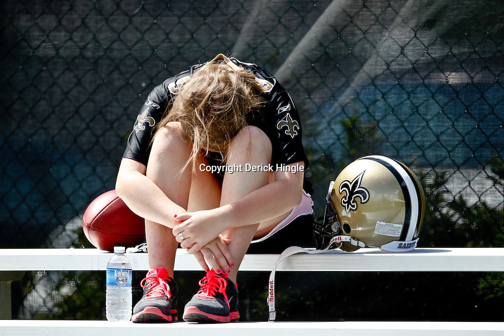July 29, 2011; Metairie, LA, USA; A New Orleans Saints fan sits in the stands  during the first day of training camp at the New Orleans Saints practice facility. Mandatory Credit: Derick E. Hingle