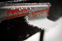 JEROME A. POLLOS/Press...White ice crystals, known as radiation frost, decorate the flag on a mail box Wednesday morning in Coeur d'Alene. The tiny spikes form on cold clear nights when radiation losses into the open skies cause objects to become colder than the surrounding air.