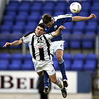 St Johnstone v St Mirren..18.12.04<br />Stuart Kean is tackled by Ian Maxwell<br /><br />Picture by Graeme Hart.<br />Copyright Perthshire Picture Agency<br />Tel: 01738 623350  Mobile: 07990 594431