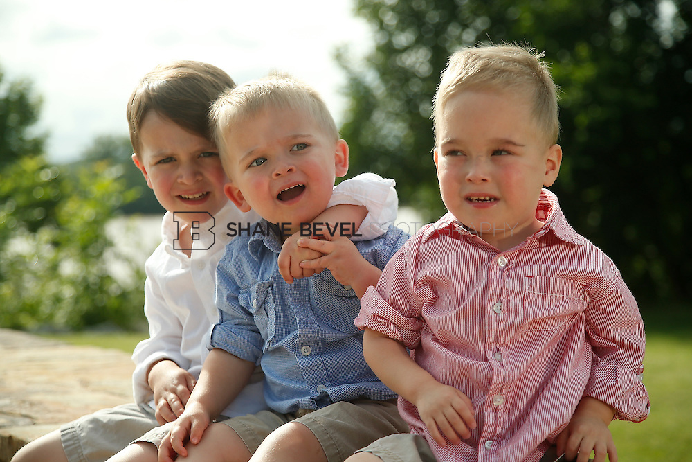 5/28/15 5:37:57 PM -- Miracle Miles and his family pose for portraits and play at the QuikTrip park for the 2015 Saint Francis Health System advertising campaign. <br /> <br /> Photo by Shane Bevel