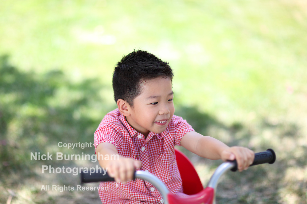 Young asian  boy on a bike with shallow depth of field