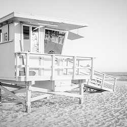 Black and white photo of Lifeguard Tower 16 along the Pacific Ocean at Santa Monica State Beach in Southern California. Copyright ⓒ 2017 Paul Velgos with All Rights Reserved.