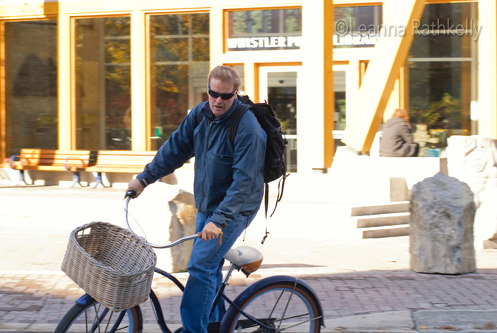 Living in Whistler means regular activities, such as walking to work, catching a bus, going to school and taking care of your health. Here Tom Cole rides his bike to work.