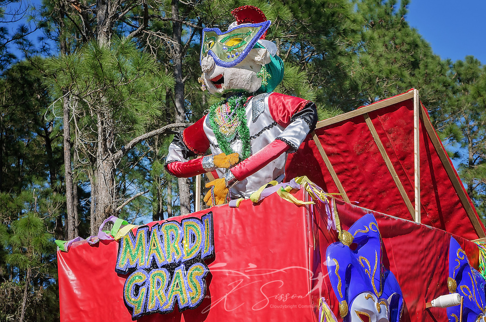 A float makes its way down Bienville Boulevard in Dauphin Island's first People's Parade during Mardi Gras, Feb. 4, 2017, in Dauphin Island, Alabama. French settlers held the first Mardi Gras in 1703, making Mobile's celebration the oldest Mardi Gras in the United States. The first parade of the season is traditionally held on Dauphin Island and draws thousands. (Photo by Carmen K. Sisson/Cloudybright)