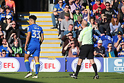AFC Wimbledon striker Lyle Taylor (33) yellow card during the EFL Sky Bet League 1 match between AFC Wimbledon and Southend United at the Cherry Red Records Stadium, Kingston, England on 25 March 2017. Photo by Matthew Redman.
