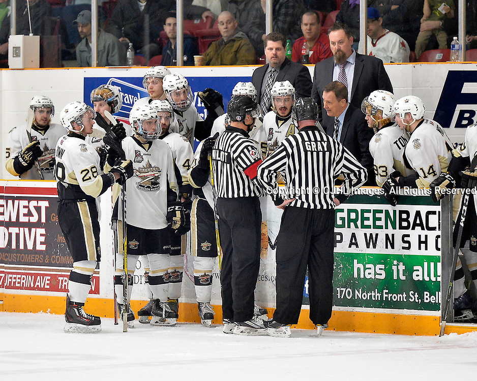 TRENTON, ON  - APR 15,  2017: Ontario Junior Hockey League, Championship Series.  Georgetown Raiders vs the Trenton Golden Hawks in Game 2 of the Buckland Cup Final.  OHA Referee Jesse Wilmot talks with Trenton Golden Hawks Head Coach Jerome Dupont late in the third period.<br /> (Photo by Shawn Muir / OJHL Images)