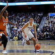 UNCASVILLE, CONNECTICUT- DECEMBER 4: Kia Nurse #11 of the Connecticut Huskies drives to the basket defended by Joyner Holmes #24 of the Texas Longhorns  during the UConn Huskies Vs Texas Longhorns, NCAA Women's Basketball game in the Jimmy V Classic on December 4th, 2016 at the Mohegan Sun Arena, Uncasville, Connecticut. (Photo by Tim Clayton/Corbis via Getty Images)