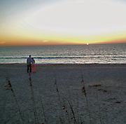 couple enjoying Florida beach sunset