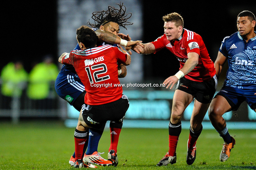 Ma'a Nonu of the Blues is tackled by Dan Carter  and Colin Slade of the Crusaders in the Super rugby  match,  Crusaders v The Blues, at AMI Stadium, Christchurch, on the 5 July 2014 . Photo:John Davidson/www.photosport.co.nz
