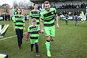 Forest Green Rovers Christian Doidge(9) with mascot during the EFL Sky Bet League 2 match between Forest Green Rovers and Notts County at the New Lawn, Forest Green, United Kingdom on 9 February 2019.