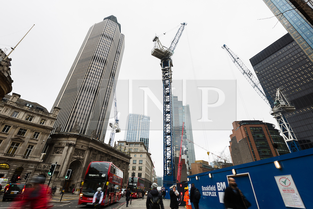 """© Licensed to London News Pictures. 10/03/2016. London, UK. Construction at the site of 22 Bishopsgate (right) and Tower 42 (left) in London. If completed, the 62-storey, 295 meter glass and steel tower would become the City of London's tallest ever skyscraper, standing three times the height of Big Ben. But the scheme is under threat following """"right-to-light"""" legal discussions with local residents, heritage groups and the owners of neighbouring properties including Tower 42, the Baltic Exchange and St Helen's church. Photo credit : Vickie Flores/LNP"""
