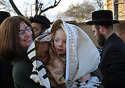 On the 3rd birthday of an Orthodox Jewish boy he has his first ever hair cut in a ceremony called an Upsherin, leaving his peyos (sideburns) to grow. This symbolic ceremony sees the baby turn into a boy, he begins to learn the alpha bet and Torah. Wrapped in his brand new Tallit (prayer shawl) hid mother carries him with his family to his brand new school.