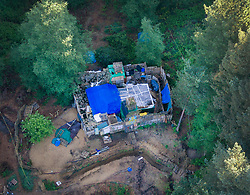 © Licensed to London News Pictures. 20/05/2017. Coldharbour, UK. The 'Protection Camp' on Leith Hill.  Protestors have constructed and occupied a fort and some trees on the site of a proposed oil well drilling rig. Planning permission for 18 weeks of exploratory drilling was granted to Europa Oil and Gas in August 2015 after a four-year planning battle. The camp was set up by protestors in October 2016 in order to draw  attention to plans to drill in this Area of Outstanding Natural Beauty (AONB) in the Surrey Hills. The camp has received support from the local community.  Photo credit: Peter Macdiarmid/LNP