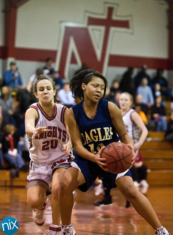 First Assembly's Lundyn Harris tries to keep the ball away against Northside Christian Academy's Jessica Viole Tuesday night in Charlotte. First Assembly won the game 55-7.