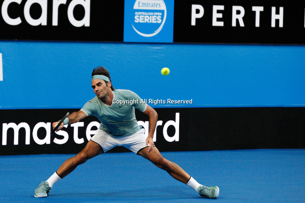 02.01.2017. Perth Arena, Perth, Australia. Mastercard Hopman Cup International Tennis tournament. Roger Federer (SUI) reaches for a fore hand deep in the base court during his match against Dan Evans (BGR). Federer won 6-3, 6-4.
