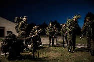 Cadets during night training in the forests in Central Lithuania.