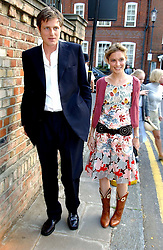 ZAC GOLDSMITH and his wife SHEHERAZADE at Sir David & Lady Carina Frost's annual summer party held in Carlyle Square, London on 6th July 2004.