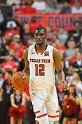 LUBBOCK, TX - MARCH 3: Keenan Evans #12 of the Texas Tech Red Raiders brings the ball up court during the game against the TCU Horned Frogs on March 3, 2018 at United Supermarket Arena in Lubbock, Texas. Texas Tech defeated TCU 79-75. Texas Tech defeated TCU 79-75. (Photo by John Weast/Getty Images) *** Local Caption *** Keenan Evans