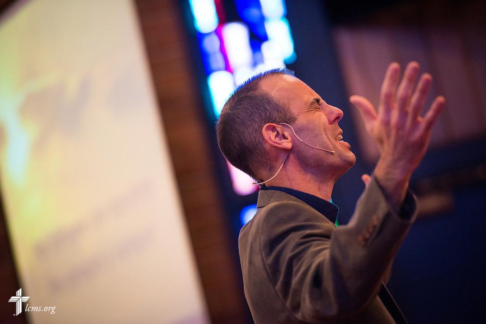The Rev. Brandon Martin, associate pastor of Salem Lutheran Church, prays during a monthly bilingual worship on Sunday, Nov. 22, 2015, at the church in Springdale, Ark. LCMS Communications/Erik M. Lunsford