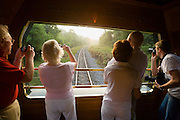 Eastern & Oriental Express. Passengers enjoy the sunrise from the Observation Car in the back.