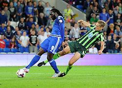 A late tackle from Dannie Bulman of AFC Wimbledon as Kenwyne Jones of Cardiff City shoots - Mandatory by-line: Paul Knight/JMP - Mobile: 07966 386802 - 11/08/2015 -  FOOTBALL - Cardiff City Stadium - Cardiff, Wales -  Cardiff City v AFC Wimbledon - Capital One Cup
