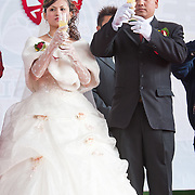 Bride and groom toast their guests at a wedding in Namasiya Township, Kaoshiung County, Taiwan.
