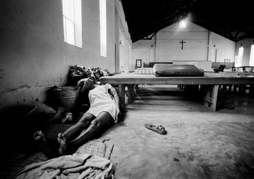 A Tutsi killed by interhamwe militias in a church at the border between Rwanda and Zaire. Apr. 1994 -<br /> The sun had set over the rwandan capital Kigali as president Juvenal Habyarimana's plane approached the city's airport on 6.april 1994.Suddenly, out of the darkness, a rocket hit the plane and sent it crashing to the ground, killing everyone on board.over the next three month's, more than 800.000 rwandans would be murdered, many cut down with machetes, killed by neighbours and countrymen, in a ferocious ethnic genocide that was all but ignored by the international world.