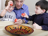 (from left) Sam Bonanno, 7; John Valassiades and Grant Kopan, 4 with the red eggs of a traditional Greek Orthodox Easter, Monday, March 24, 2008.  The bowl that held the eggs is hand carved and hand painted.
