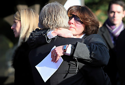© under license to London News Pictures.  19/11/10..Friends of murdered millionairess Joanna Brown, 46, grieve at the church after Joanna's memorial service, St Mary's Church, Church Road, Winkfield, Berkshire. Joanna's body was found in woodland in Windsor Great Park on November 5th. Her husband, Robert Brown, also 46, has been charged with her murder. ..Picture credit should read: Rebecca Mckevitt/London News Pictures