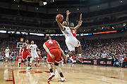 January 20, 2014: Benny Parker (3) of the Nebraska Cornhuskers going for a lay up against Shannon Scott (3) of the Ohio State Buckeyes and Aaron Craft (4) of the Ohio State Buckeyes at the Pinnacle Bank Arena, Lincoln, NE. Nebraska won in the game against Ohio State 68 to 62.