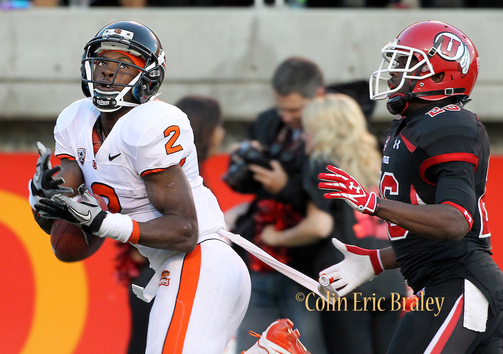 Oregon State wide receiver Markus Wheaton (2) is unable to hold on to a pass in the endzone as Utah defensive back Ryan Lacy (26) defends during the first half of an NCAA college football game at Rice-Eccles Stadium, Saturday, Oct. 29, 2011, in Salt Lake City.  (AP Photo/Colin E. Braley).