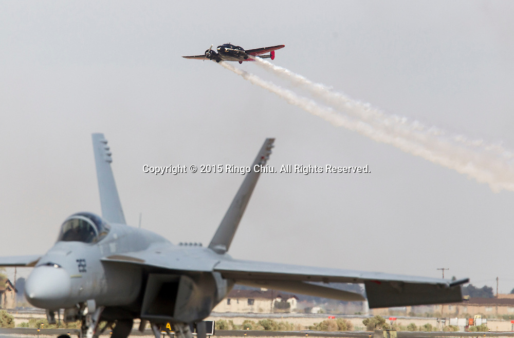 Matt Younkin, Beach 18, performs with Gene Soucy, during Los Angeles County Air Show, in Lancaster, California on March 21, 2015. (Photo by Ringo Chiu/PHOTOFORMULA.com)
