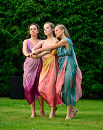 Old Westbury, New York, U.S. 22nd June 2013. Dancers in Lori Belilove & The Isadora Duncan Dance Company, perform a dance of the Three Graces, at the Midsummer Night event at Old Westbury Gardens, throughout the illuminated grounds of the historic Long Island Gold Coast estate.<br />