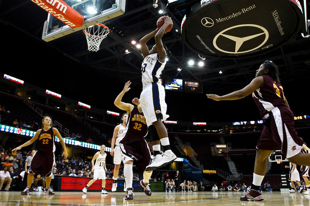 13 March 2010:  Kent State's Yoshica Spears (23) goes up for a basket against Central Michigan's Heidi Warczinsky (32) during the MAC Tournament game basketball game between Kent State and Central Michigan at Quicken Loans Arena in Cleveland, Ohio.