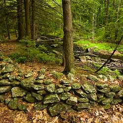 An old stone wall next to Muschopauge Brook in Holden, Massachusetts.  Worcester County.