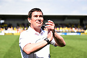 Burton Albion manager Nigel Clough celebrates with fans after Burton Albion's against-the-odds championship survival during the EFL Sky Bet Championship match between Burton Albion and Reading at the Pirelli Stadium, Burton upon Trent, England on 7 May 2017. Photo by Richard Holmes.