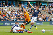 Hull City defender Jordy de Wijs (4) brings down Millwall forward Matt Smith (10), Millwall midfielder Jed Wallace (7) calls for a penalty, during the EFL Sky Bet Championship match between Millwall and Hull City at The Den, London, England on 31 August 2019.