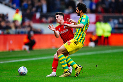Callum O'Dowda of Bristol City is challenged by Ahmed Hegazy of West Brom - Rogan/JMP - 22/02/2020 - Ashton Gate Stadium - Bristol, England - Bristol City v West Bromwich Albion - Sky Bet Championship.