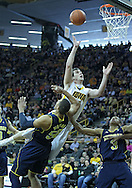 January 14, 2011: Iowa Hawkeyes forward Zach McCabe (15) puts up a shot over Michigan Wolverines forward Jordan Morgan (52) during the NCAA basketball game between the Michigan Wolverines and the Iowa Hawkeyes at Carver-Hawkeye Arena in Iowa City, Iowa on Saturday, January 14, 2011.