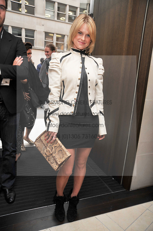 ALICE EVE at a reception hosted by Vogue and Burberry to celebrate the launch of Fashions Night Out - held at Burberry, 21-23 Bond Street, London on 10th September 2009.